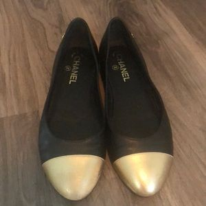 Genuine black leather Chanel flats with gold toe